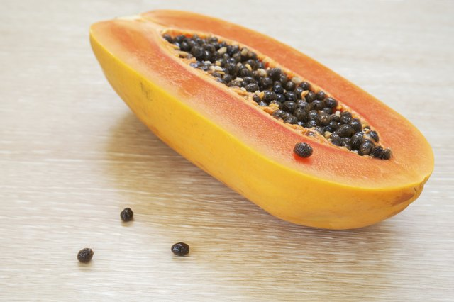 Halved papaya with seeds