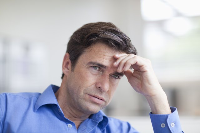 Stressed man with hand on his forehead