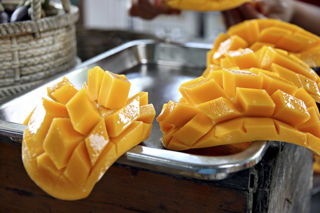sliced mango in kitchen