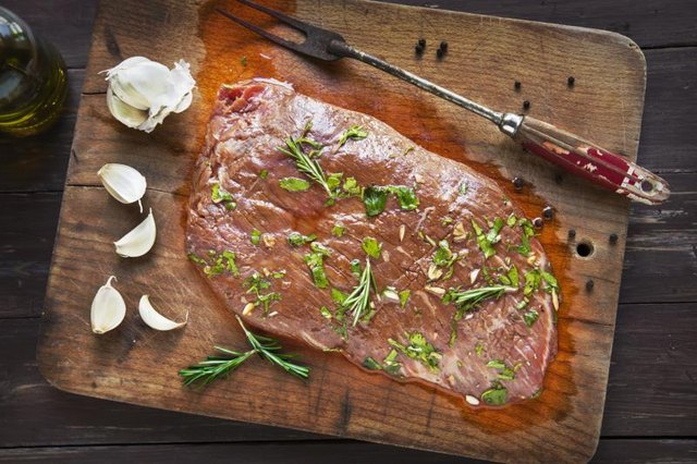 The traditional London broil is cooked quickly in the oven with a flank steak.