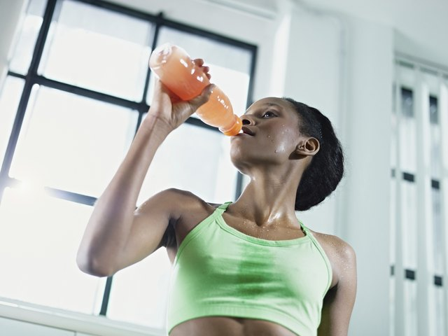Woman drinking a recovery shake