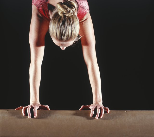 Handstands strengthen the core muscle group including the lower back.