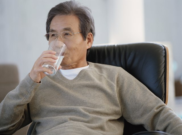 Mature man drinking glass of water