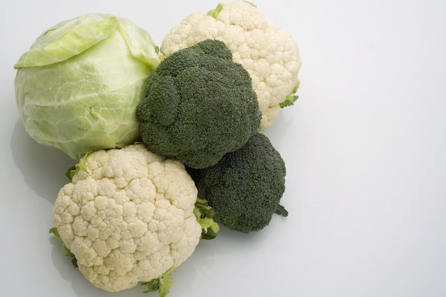 Fresh broccoli, cabbage, and cauliflower.