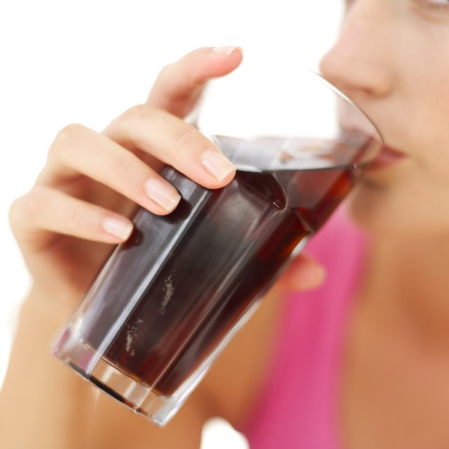 Woman drinking cola from glass