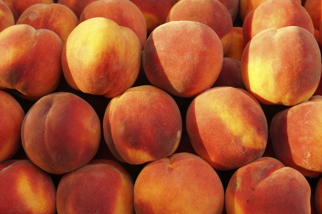 Peaches for sale at a market.