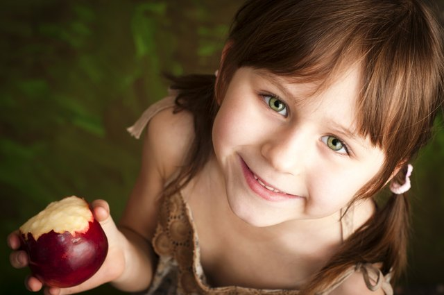Young girl with apple