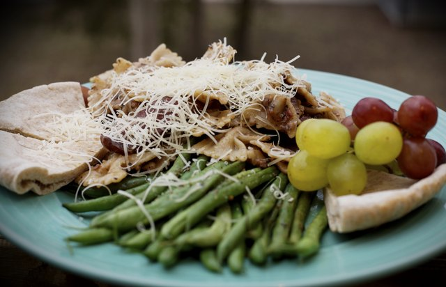 small portion of pasta with side of green beans