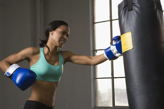 Woman punching heavy bag
