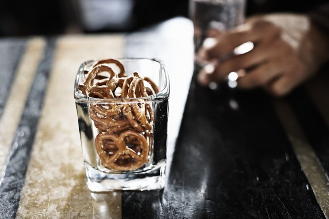 Drinking establishments put out salty snacks like pretzels and nuts precisely so you will get thirsty and gravitate back to bar.