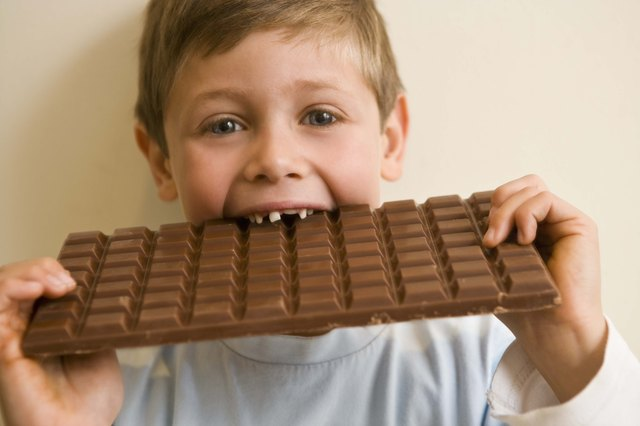 Boy eating an oversized chocolate bar