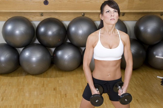 Lightly grip the dumbbells in each hand