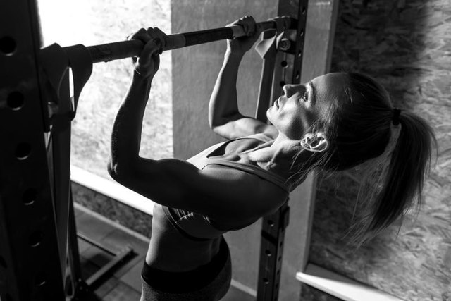 Chin-ups engage your biceps and back.