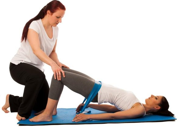 Your physical therapist might add resistance to hip bridges.