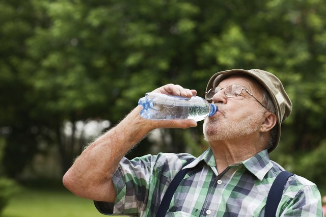 Does drinking water tea help you lose weight livestrong man drinking from a bottle of water sciox Gallery
