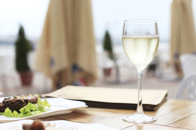 A glass of white wine with dinner on the terrace.