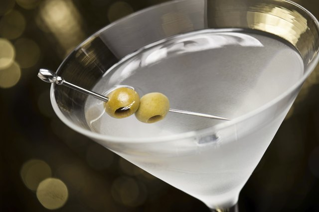 Close up of a vodka martini with olives