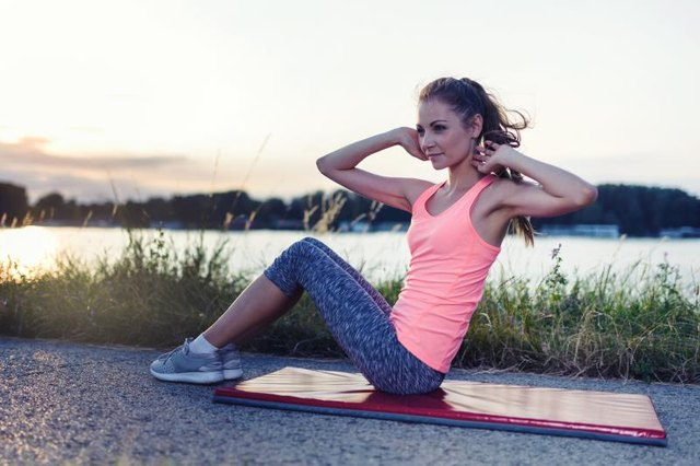 To tone the obliques, do crunches with a twist.