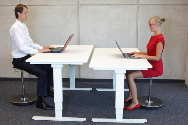 Maintaining good posture at work is key to spinal health.