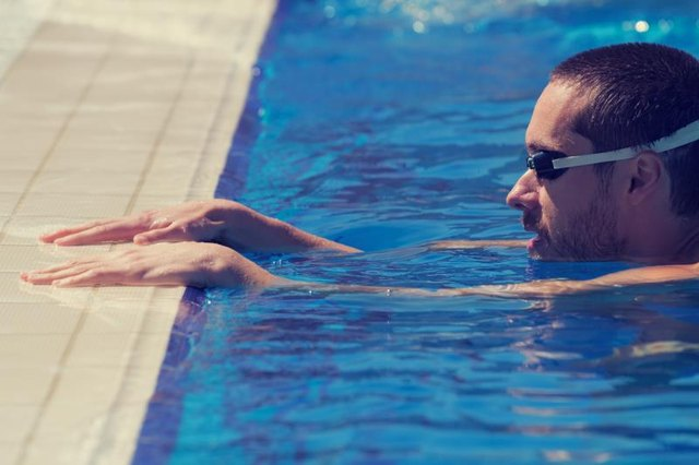 With some exercises, you'll need to hold onto the edge of the pool.