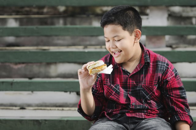 This kid seems to love his Egg McMuffin, but what do you think? Should he be eating it?