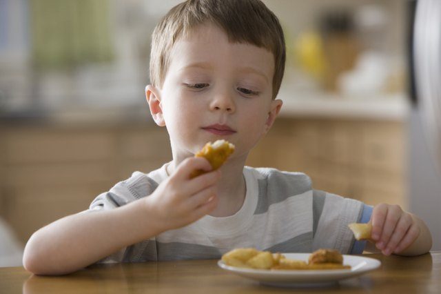 Even this kid is skeptical of McNuggets. He doesn't want to eat Dimethylpolysiloxane.