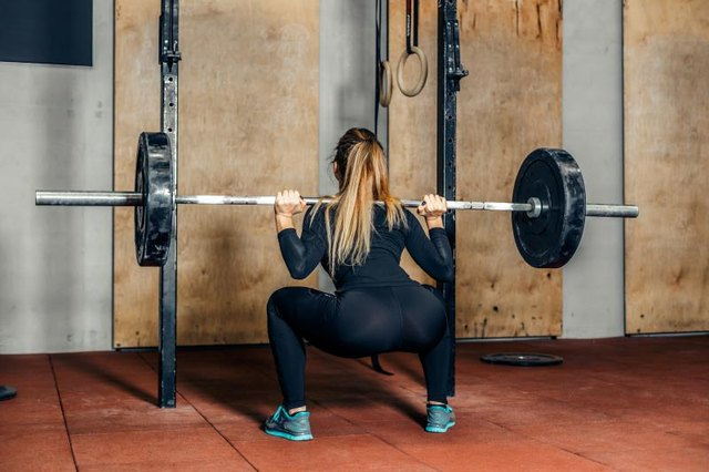 Squats engage your lower back muscles more when performed with weights.