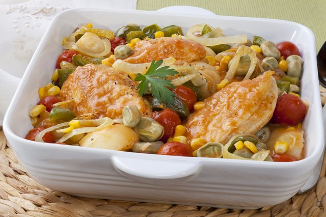 A chicken stew made with corn, lima beans, potatoes, peppers, onions, and tomatoes.