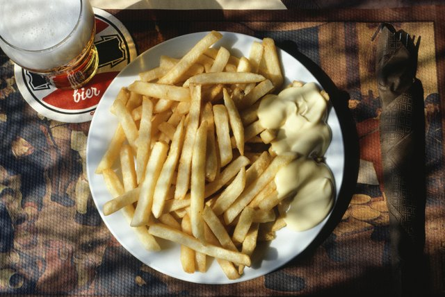 Close-up of a plate of french fries and mayonnaise