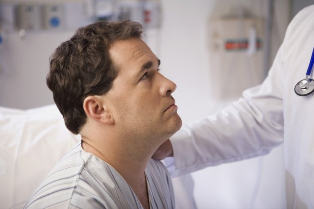 Doctor talking to male patient