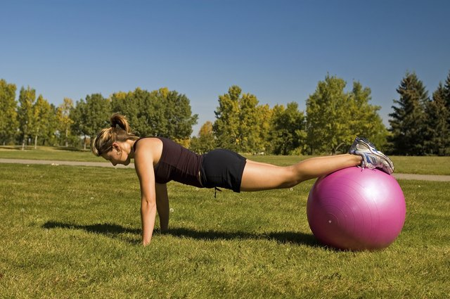 Perform pushups while supporting your legs at the shins on a stability ball.