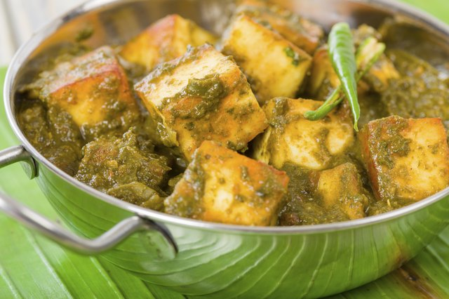 Paneer mixed with cooked spinach