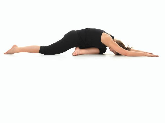 In the Pigeon pose, your knee is under your chest.