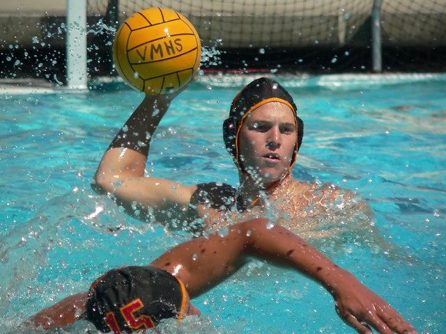 Water polo player passing ball