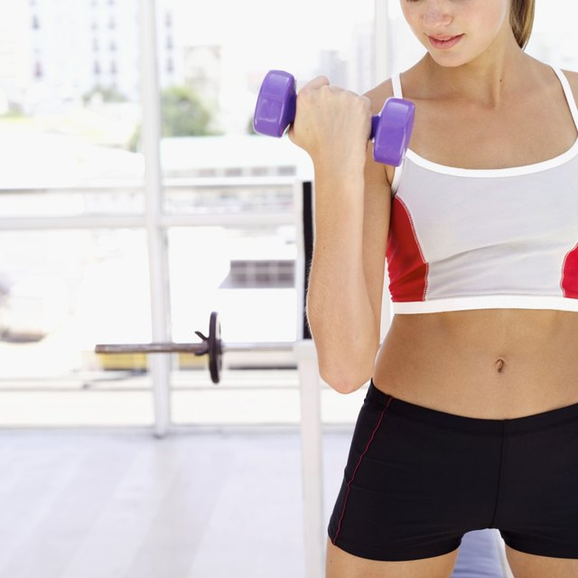 Holding a dumbbell in each hand, step up onto the box with your left leg.