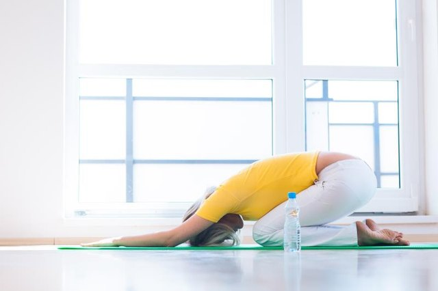 Yoga can keep you active without putting too much strain on your injuries.