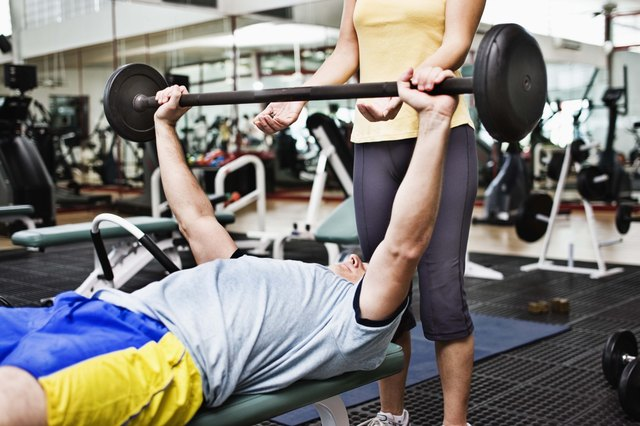 Many swimmers lift weights to increase strength throughout the whole body.