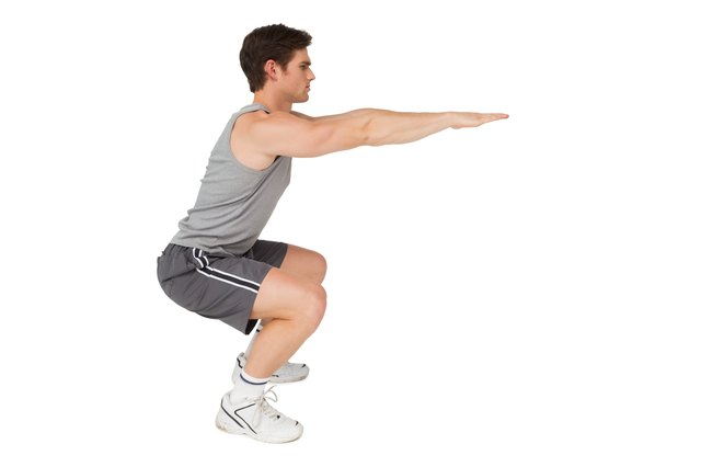 Squats are a good way to activate and strengthen your quadriceps muscle.