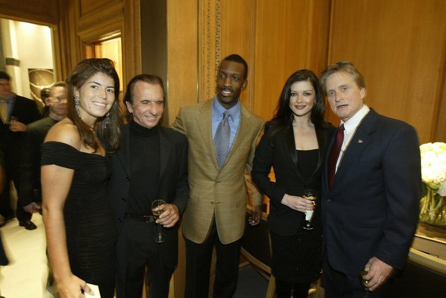 Race car driver Emerson Fittipaldi and girlfriend, track star Michael Johnson, and actors Catherine Zeta-Jones and Michael Douglas, 2002