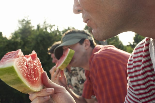 Friends eating watermelon in summer