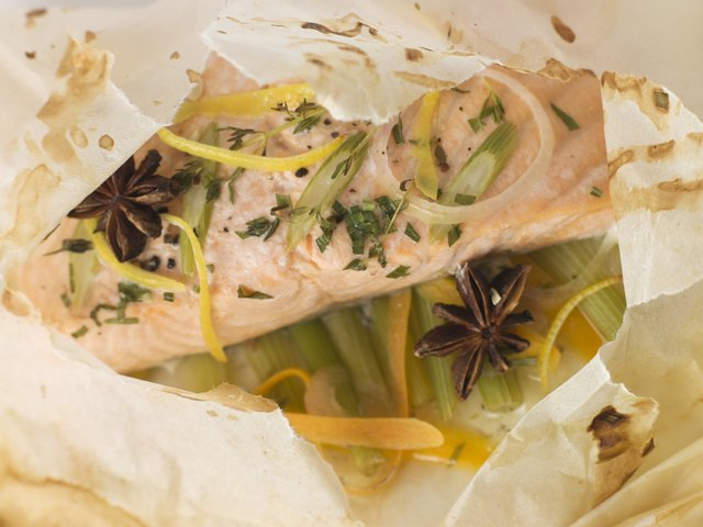 Baked salmon with herbs in baking pouch