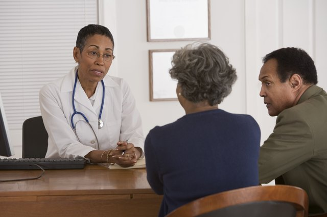 Doctor consults with seniors