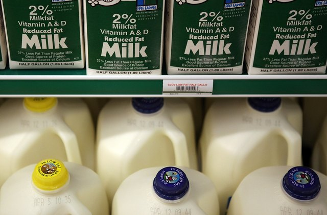 Cartons of milk in dairy aisle of market