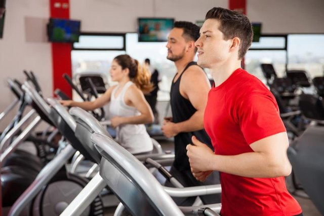 Run on a treadmill to raise your heart rate.