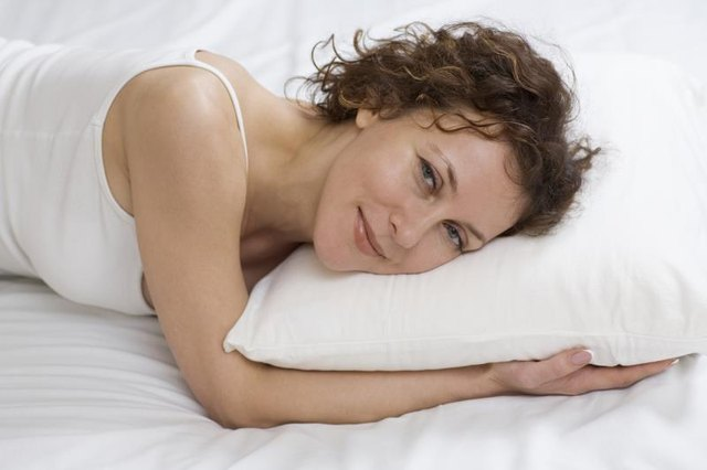 Household items such as a pillow can be used for shoulder exercises.