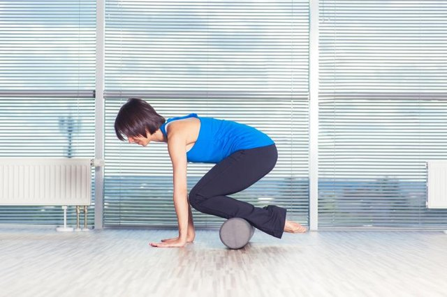 Hug your belly in toward your spine as you control the roller.