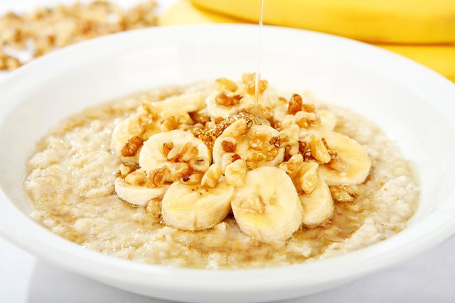 bowl of oatmeal with sliced bananas