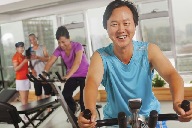 Man on exercise bike at gym