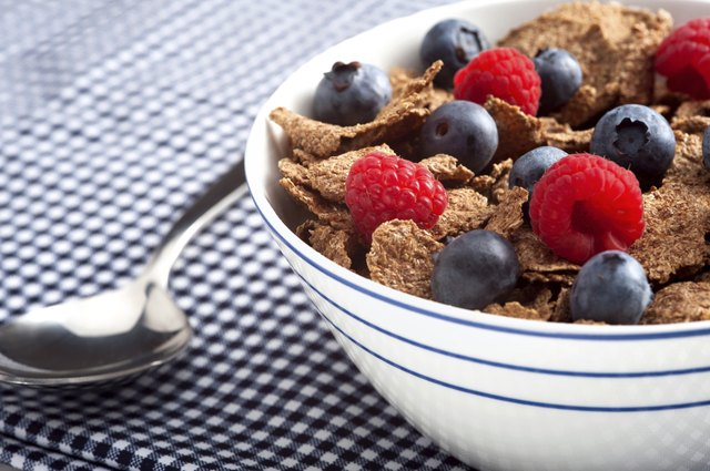 Bran cereal with raspberries and blueberries