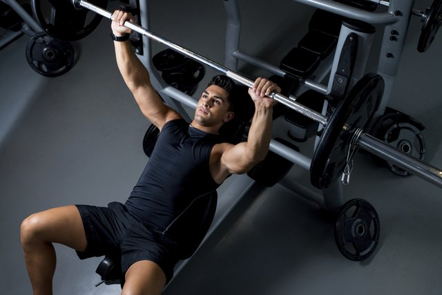 Participate in a weight-training workout that targets your pecs at least two days per week.